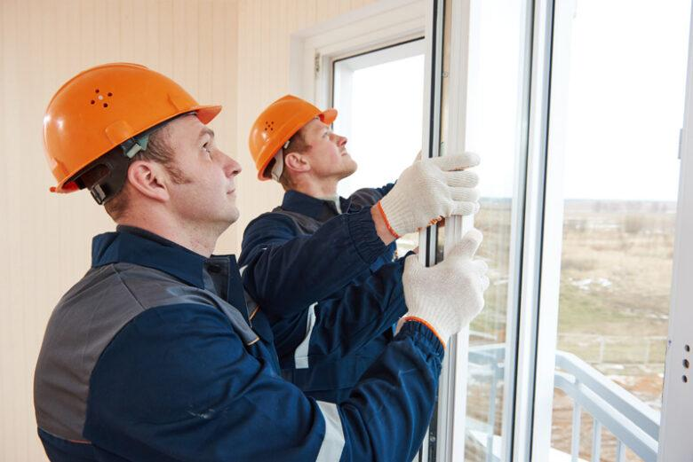 Two Window Installation Experts Installing Casement Windows in North Carolina.