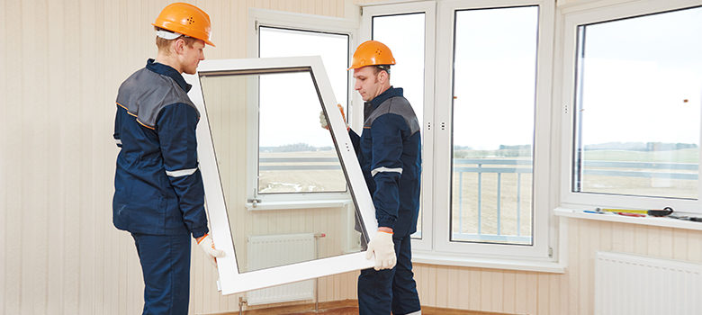 Two workers Install Casement Windows in a home.