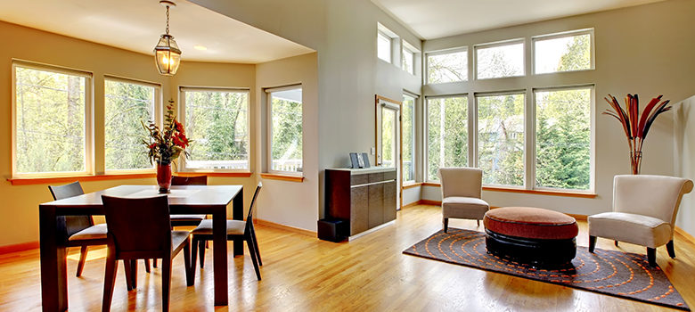 Open-concept living space with large, custom picture windows